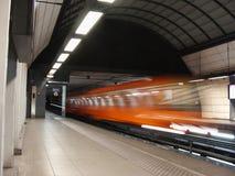 Subway train. Orange subway leaving the station taken a slow speed Stock Photo