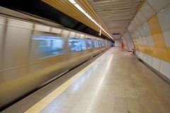 Subway train approaching a platform Royalty Free Stock Images