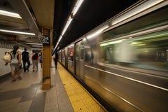 Subway train arriving at platform in Penn Station. New York City, New York, USA Stock Photo