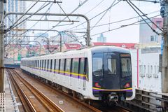 Subway train arriving to station. Urban scene with subway train arriving to the station, Shanghai stock photography