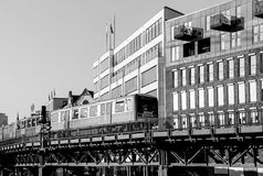 Subway Train on a Bridge in Monochrome. Hamburg, Germany - Februar 15, 2017: Subway train on a bridge in front of buildings near the station Baumwall. The Stock Image