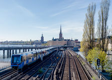 Subway train on a bridge moving towards Old Town subway station Royalty Free Stock Photos