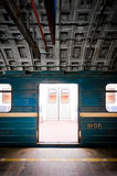Subway train in dark tunnel Stock Images