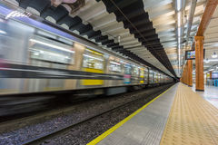 Subway train enters station Royalty Free Stock Images