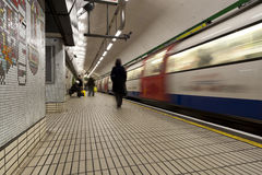 Subway train in motion. With people in the station Stock Image