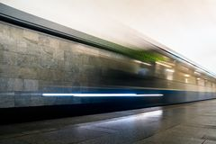 Subway train in motion arriving at station. Train in motion blur arriving at subway station Stock Photos