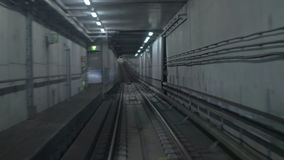 Subway train moving in tunnel and arriving to the station stock video