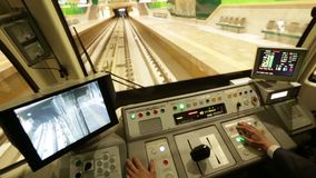 Subway train operator driver driving. A subway train operator is driving the train for its first ride from the Sofia Airport extension stock footage