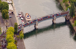 Subway train outdoors on a bridge over Seine river Royalty Free Stock Images