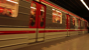 Subway train with passengers arriving to Prague underground metro station. PRAGUE, CZECH REPUBLIC - MAY 24, 2015: Subway train with passengers arriving to Prague stock video footage