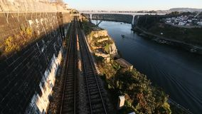 Subway train passing in a tunnel on the bank of the Dora river in Porto stock video footage