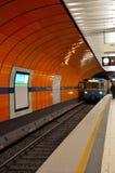 Subway train pulls into station: Munich, Germany Stock Photos