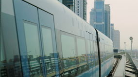 The subway train rides among the glass skyscrapers in Dubai, UAE. Dubai Metro as world`s longest fully automated metro network 75 km stock video