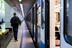 Subway train staying on a metro station with doors open with defocused background s Stock Photography