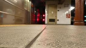 Subway Train. A subway train, out of focus, leaving a station and entering the tunnel stock video