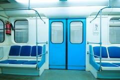 Subway vehicle. Empty subway vehicle with blue seats Royalty Free Stock Images