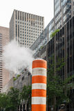 Subway vent. Steam rising out of a subway vent in a street of New York City Stock Photography