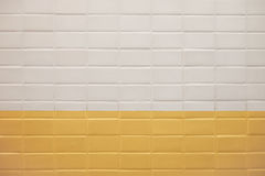 Subway wall background with white and yellow tiles texture Royalty Free Stock Photography