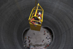 Subway Works. Workers descend in a basket, to the works of expansion of the subway of Mexico City Stock Image