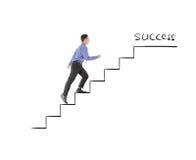 Succès de marche d'homme d'affaires sur des escaliers de bénéfice Photographie stock