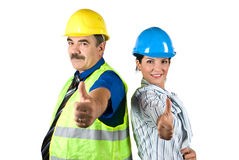 Succcessful architects people giving thumbs-up. Two happy architects with hardhat standing back to back and giving thumbs -up isolated on white background,check Stock Photography