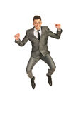 Succcessful businessman leaping. Successful happy business man leaping isolated  on white background Stock Photos