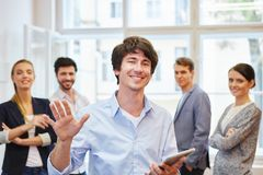 Succcessful young man. Succcessful young men as manager in front of business team Royalty Free Stock Photography