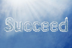 Succeed font cloud on a blue sky Royalty Free Stock Photo