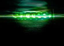 Succeed Text on Green Ocean Sea Horizon at Night Royalty Free Stock Photos