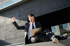 Succes businessman with a laptop computer Stock Photography