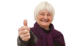 Succes - oudere vrouw die u de duimen opgeeft Stock Afbeeldingen