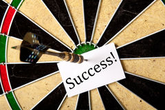 Succes pierced on dartboard Stock Photography