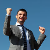 Succes square. Young businessman in blue sky in summer Royalty Free Stock Photography
