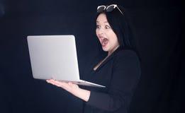 Succes sul computer portatile Immagini Stock