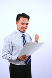 Succesful asian bussinessman, very happy look at the white paper Stock Image