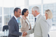 Succesful business team shaking hands and high fiving. In the office Stock Images
