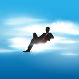 Succesful businessman sitting on a cloud Royalty Free Stock Images