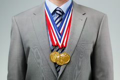 Free Succesful Businessman With Gold Medals Stock Photo - 41761150