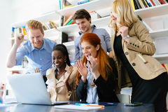 Succesful company celebrates business success. With coworkers being happy Stock Photo