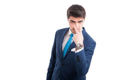 Succesful entrepreneur spying on you. Or doing look into my eyes gesture isolated on white with advertising area Royalty Free Stock Photography