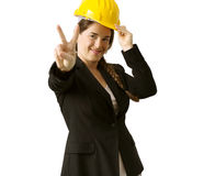 Succesful female engineer with safety helmet over white backgrou Royalty Free Stock Image