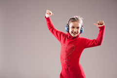 Succesful girl happily listening to the music Royalty Free Stock Photography