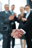 Succesful handshake. With business people aplauding Royalty Free Stock Image