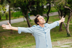 Succesful man with open arms celebrating Stock Photos