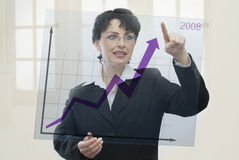 Succesful year. Businesswoman showing with her finger the growth of her successful achievements in 2008 Royalty Free Stock Photos