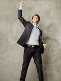 Succesful young manager presenting the victory gesture Royalty Free Stock Photo
