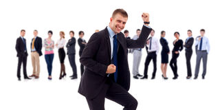Succesfull business man and his team. Isolated over a white background royalty free stock image