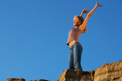 Success. Young woman tourist at the top of mountain Royalty Free Stock Photography