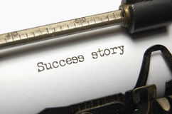 Success. The typed words Success Story on an old typewriter Stock Photo