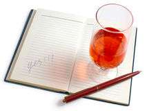 Success. Rummer with a wine, the pen, a notebook - successful end of the bargain Stock Photo